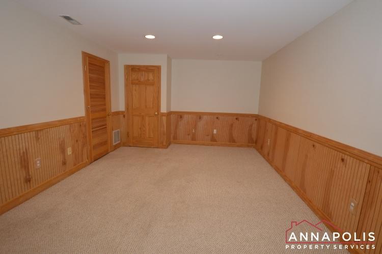 909 Arkblack Terrace-Family room and Bedroom 3a.JPG