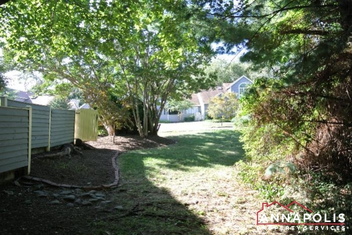 906 Windwhisper Lane-side yard.JPG